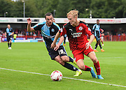 Crawley's man of the match Christian Scales defending under pressure from Michael Harriman during the Sky Bet League 2 match between Crawley Town and Wycombe Wanderers at the Checkatrade.com Stadium, Crawley, England on 29 August 2015. Photo by David Charbit.