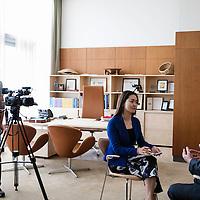 CCTV America correspondent Sally Zhang, Correspondent interviews Peter Thomson.