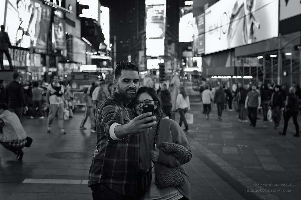 Couple taking  selfie in Times Square, New York, NY, US