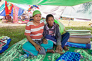 Ibu Anizar (40) and son Moha. Rian (15) found shelter at the Mayor's compound after a 7.5 earthquake magnitude hit off the coast of Donggala, Palu Sulawesi Central, Indonesia on Sept. 28th causing a tsunami.  They've been displaced for 1 week.  They shared the tent with 13 other people.  Ibu Anizar has 5 kids, 4 teenagers and 1 toddler
