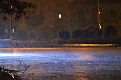 January 3, 2018 - Ankara, Turkey - A car's headlights illuminate rain drops on a rain-drenched road as heavy rain falls in the winter season in Ankara, Turkey on January 3, 2018. (Credit Image: © Altan Gocher/NurPhoto via ZUMA Press)