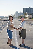 Senior couple on promenade, holding hands