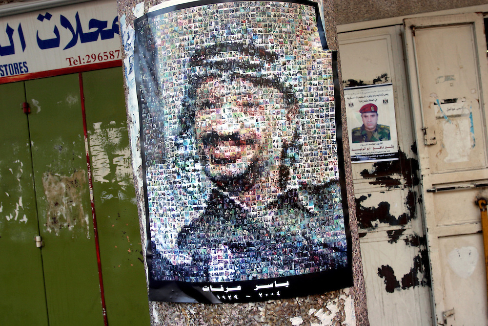 Posters on a street in the centre of the Palestinian capital Ramallah, on Friday, Nov. 11, 2005, portraying former President Yasser Arafat (front) and of Bashir Nafa (back), the late head of military intelligence in the West Bank, and the most notable victim of the recent wave of terrorist attacks in Amman, Jordan, which have left 53 dead, 23 of whom Palestinian. On the day of the first anniversary of former Palestinian leader Yasser Arafat, the Palestinian people mourns another one of their key men and try to face an uncertain future. Almost all the businesses around Ramallah have been closed for three days to honour the victims of another bomb, and in protest to the hideous action, allegedly carried out by Iraqi suicide bombers. **ITALY OUT**....