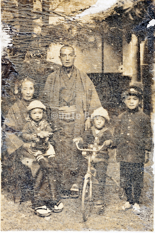 deteriorating family group portrait Japan 1914