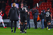 Daniel Stendel  of Barnsley (Manager) hugs Dimitri Cavare of Barnsley (12) after the EFL Sky Bet League 1 match between Doncaster Rovers and Barnsley at the Keepmoat Stadium, Doncaster, England on 15 March 2019.