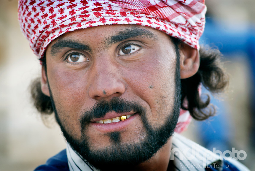 Portrait of a young man wearing a bedouin keffiah