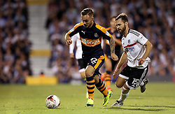 Adam Armstrong of Newcastle United runs with the ball past Michael Madl of Fulham - Mandatory by-line: Robbie Stephenson/JMP - 05/08/2016 - FOOTBALL - Craven Cottage - Fulham, England - Fulham v Newcastle United - Sky Bet Championship