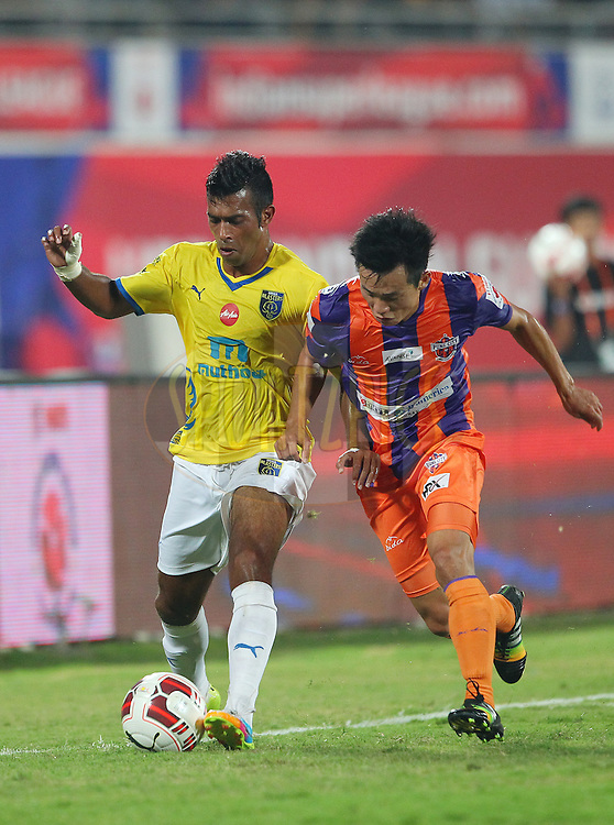 Milagres Gonsalves of Kerala Blasters FC  battles with Park Kwang-il of FC Pune City during match 17 of the Hero Indian Super League between FC Pune City<br /> and Kerala Blasters FC held at the Shree Shiv Chhatrapati Sports Complex Stadium, Pune, India on the 30th October 2014.<br /> <br /> Photo by:  Ron Gaunt/ ISL/ SPORTZPICS