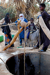 Niger, Agadez, Tidene, 2007. Rissa Ixa consults with Tuareg nomads using another of his wells. Each bore is different and requires maintenance.