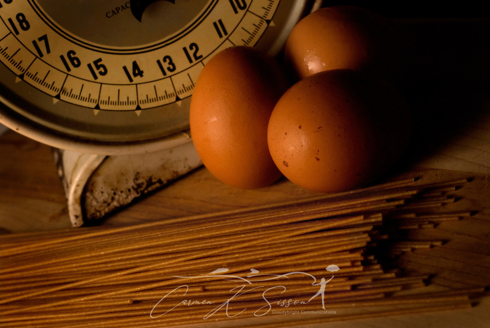 Whole wheat spaghetti pasta and brown farmer's eggs are pictured with a vintage food scale, July 15, 2008, in Northport, Alabama. (Photo by Carmen K. Sisson/Cloudybright)