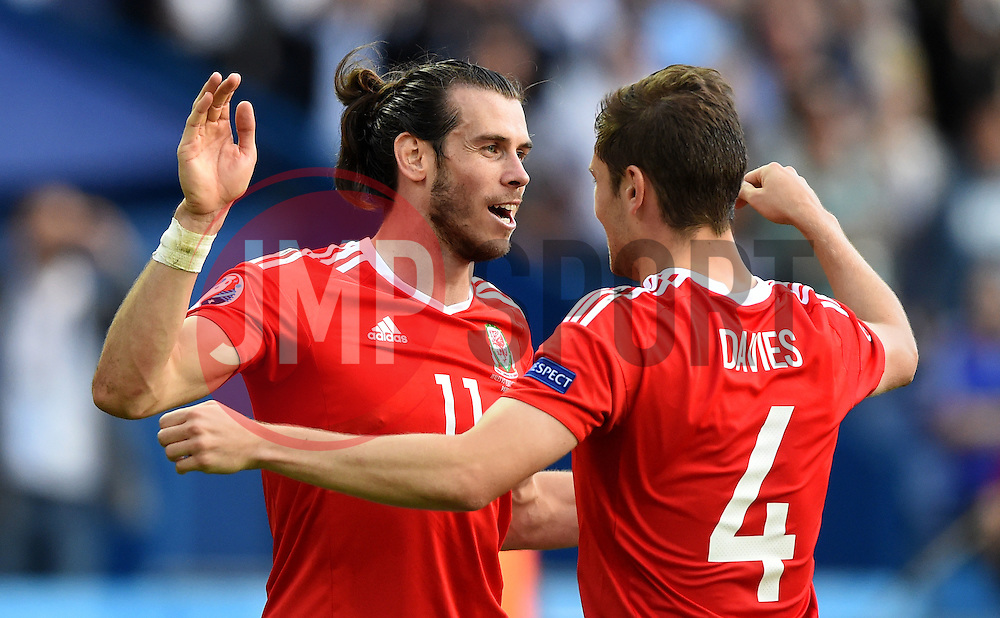 Gareth Bale of Wales celebrates  with Ben Davies of Wales after the game  - Mandatory by-line: Joe Meredith/JMP - 25/06/2016 - FOOTBALL - Parc des Princes - Paris, France - Wales v Northern Ireland - UEFA European Championship Round of 16