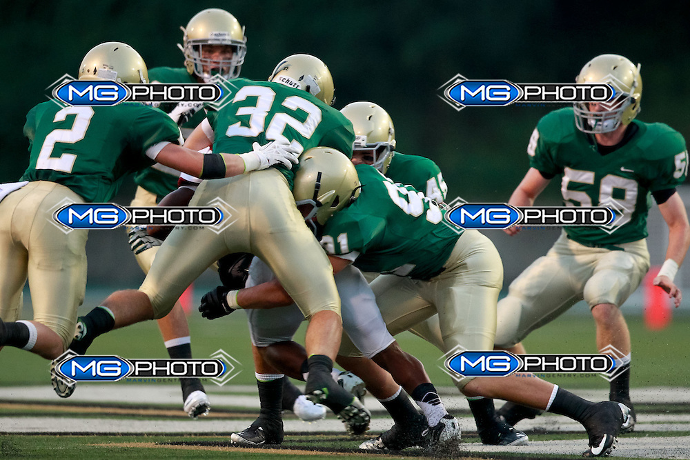 Sep 6, 2013; Mountain Brook, AL, USA;  Mountain Brook defenders gang tackle a Shades Valley ball carrier . Mandatory Credit: Marvin Gentry