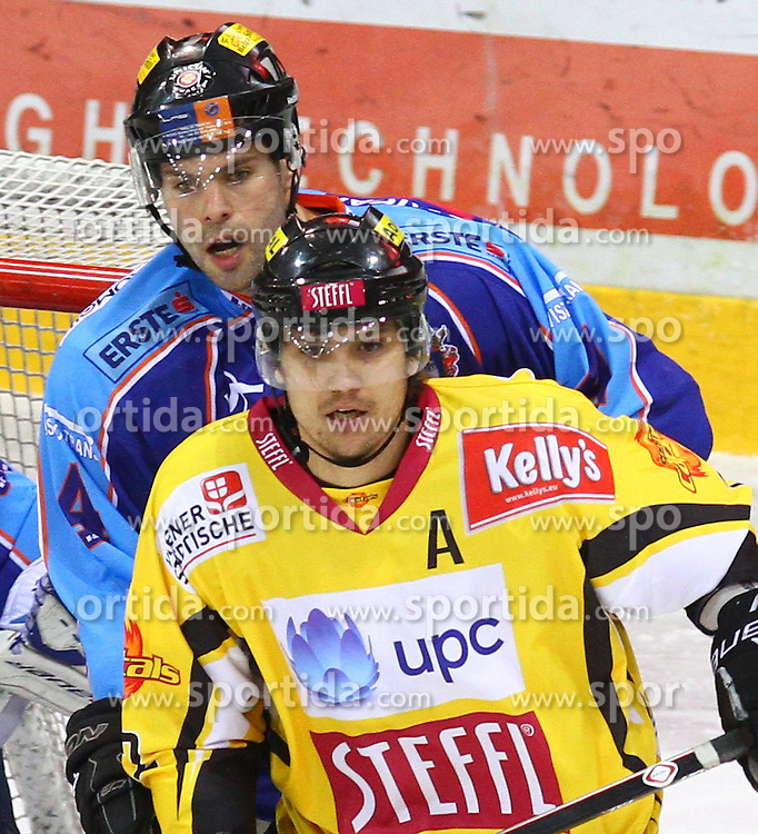 17.01.2012, Albert Schultz Halle, Wien, AUT, EBEL, UPC Vienna Capitals vs SAPA Fehervar AV19, im Bild Andras Horvath, (SAPA Fehervar AV19, #4) und Marcel Rodman, (UPC Vienna Capitals, #22) // during the icehockey match of EBEL between UPC Vienna Capitals (AUT) and SAPA Fehervar AV19 (HUN) at Albert Schultz Halle, Vienna, Austria on 17/01/2012,  EXPA Pictures © 2012, PhotoCredit: EXPA/ T. Haumer
