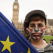 London,England,UK: 29th March 2017. Protester against May article 50 trigger playing music in Parliament square,London,UK. by See Li