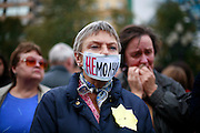 "A woman with the Russian word ""Silenced"" covering her mouth pays tribute to Russian journalist Anna Politkovskaya, murdered in Moscow on 7 October, 2006. .Known for her critical coverage of the war in.Chechnya, she was shot to death in the elevator of her apartment building in Moscow, in a killing prosecutors believe could be connected to her investigative work..Politkovskaya was a tireless reporter who had written a critical book on Russian President Vladimir Putin and his campaign in Chechnya, documenting widespread abuse of civilians by government troops..Prosecutors have opend a murder investigation into her death, said Svetlana Petrenko, spokeswoman for the Moscow prosecutor's Office. Investigators suspect the killing was connected to the work of the 48-year-old journalist, Vyacheslav Raskinsky, Moscow's first deputy prosecutor said on state-run Rossiya television."