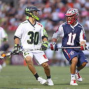 Matt Smalley #11 of the Boston Cannons tries to get the ball away from a member of the New York Lizards during the game at Harvard Stadium on July 19, 2014 in Boston, Massachusetts. (Photo by Elan Kawesch)