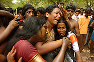 Indian transvestites cry to represent being widowed after the death of the god Aravan to celebrate the Aravani festival in the town of Koovagam in the Tamil Nadu state of India April 20, 2005. After being symbolically married to the god for one night, those that participate are widowed the next morning. The festival, popular among Indian transvestites, celebrates myth of the marriage of the Hindu Lord Aravan to Lord Krishna, who transformed himself into a woman as a reward to Aravan for sacrificing himself to ensure victory during war.