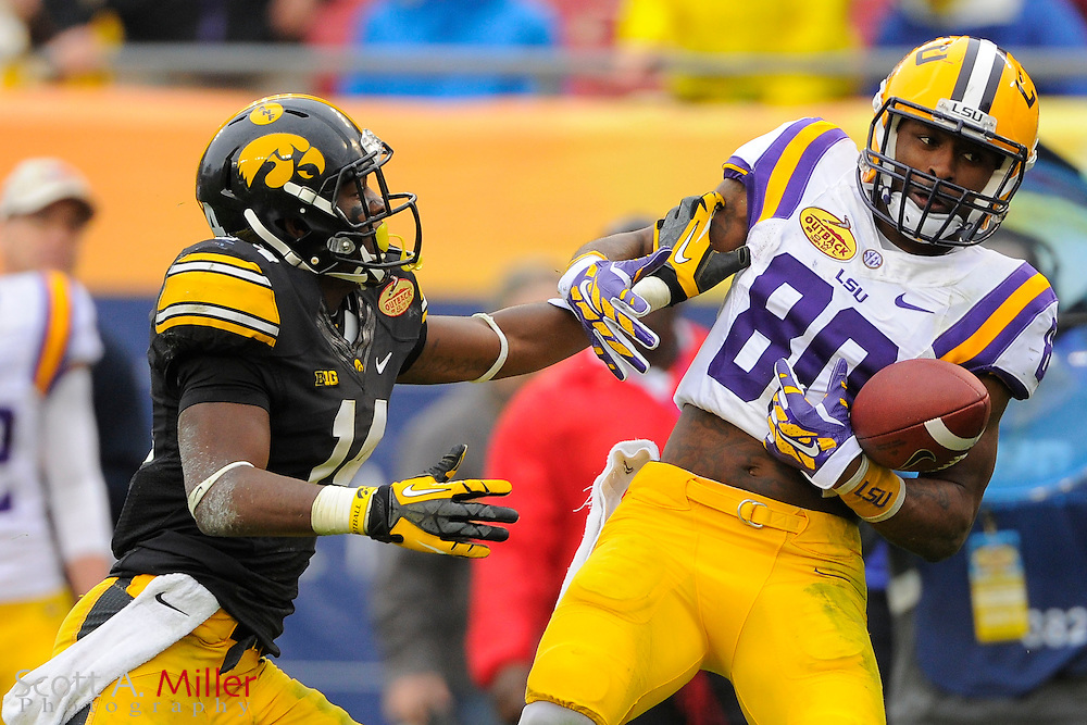 Iowa Hawkeyes defensive back Desmond King (14) breaks up a pas intended for LSU Tigers wide receiver Jarvis Landry (80) during LSU's 21-14 win in the 2014 Outback Bowl at Raymond James Stadium on Jan 1, 2014  in Tampa, Florida.            ©2014 Scott A. Miller