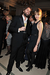 PATRICK O'NEILL and EDIE CAMPBELL at a dinner and dance hosted by Leon Max for the charity Too Many Women in support of Breakthrough Breast Cancer held at Claridges, Brook Street, London on 1st December 2011.