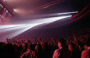 Crowd with arms in the air at a large concert arena venue Perth W.Australia 1990's.