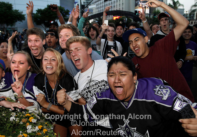Fans celebrate in the area around Staples Center following the Los Angeles Kings winning the NHL's Stanley Cup Final in Los Angeles, California, June 11, 2012. REUTERS/Jonathan Alcorn (UNITED STATES).