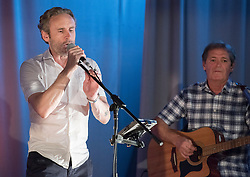 Pictured: Cal MacAninch joins Hooseband for the finale<br /> <br /> The community in Portobello came out last night in support of a locally organised campaign to try and save a local church and its attached church hall for the community. No longer needed by the church, who plan to sell it, the hall is widely used by community groups. The campaign hopes to make use of Scottish community buy-out legislation that has recently been extended to cover urban areas in one fo the first such campaigns in a Scottish urban area. Local film acting couple, Shauna Macdonald and Cal MacAninch, were instrumental in the event that featured a variety of local talent and was attended by about 150 people, packing out the church hall. Shauna brought the show together, along with her sister Kyrsta, and Cal performed on stage in both the specially written short play that opened the evening and singing with the band Hooseband at the show's finale.  <br /> <br /> <br /> © Jon Davey/ EEm
