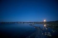 The June Full Moon rises over South Tufa at Mono Lake.