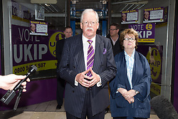 © Licensed to London News Pictures . 06/06/2014 . Newark , Nottinghamshire , UK . UKIP candidate and runner up in the Newark by-election , ROGER HELMER , gives a consolation speech and takes questions from media in front of the UKIP shop in Newark this morning (6th June 2014). Photo credit : Joel Goodman/LNP