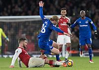 Football - 2017 / 2018 Premier League - Arsenal vs. Everton<br /> <br /> Shkodran Mustafi (Arsenal FC) times his tackle on Tom Davies (Everton FC ) at The Emirates.<br /> <br /> COLORSPORT/DANIEL BEARHAM