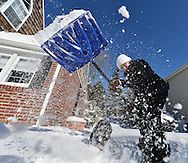 Nancy Rowen digs out from under today's snow  in Roslyn Heights.  . (January 22, 2014). © Audrey C. Tiernan