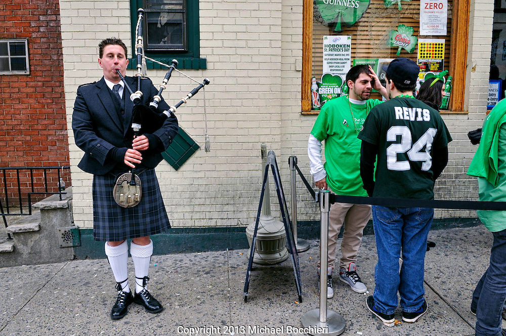 HOBOKEN, NJ - March 02:  Colin Nisbet of Hoboken plays the bagpipes for patrons outside The Shannon bar during the Lepre-Con bar crawl event as part of St. Patrick's Day festivities on March 02, 2013 in HOBOKEN, NJ. Last year marked the first time in decades that the Hoboken St. Patrick's Day parade didn't take place after organizers and city government couldn't agree on a date. Bar owners instead held a city-wide drinking event that attracted thousands to the area.  (Photo by Michael Bocchieri/Bocchieri Archive)