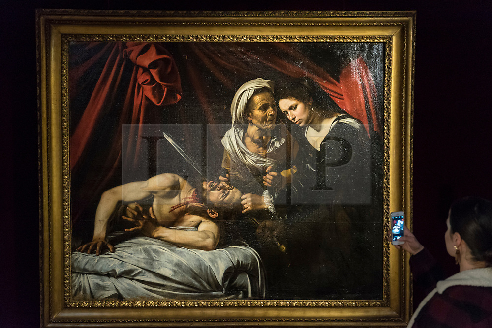 """© Licensed to London News Pictures. 01/03/2019. LONDON, UK.  The painting known as """"Judith and Holfernes"""", c1607, by Caravaggio, is seen on display to the public for the first time after being discovered in an attic in Toulouse, France five years ago where it had lain forgotten for 100 years.  The rediscovered masterpiece, currently being exhibited at the Colnaghi Gallery in London, will be shown in Paris, New York and Toulouse, before being auctioned in Toulouse on 27 June 2019.  As is customary in France, no reserve has been placed on the artwork, but it has been reported that the painting may sell for in excess of £120m.  Photo credit: Stephen Chung/LNP"""