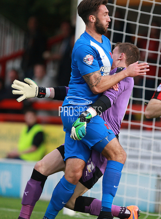 Leyton Orient striker Ollie Palmer smashes into Crawley Town goalkeeper Callum Preston during the Sky Bet League 2 match between Crawley Town and Leyton Orient at the Checkatrade.com Stadium, Crawley, England on 10 October 2015. Photo by Bennett Dean.