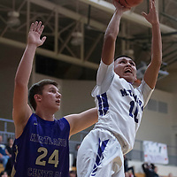 Miyamura's Gabe Lee Jr. (10) drives to the basket against Kirtland Central Thursday night in Gallup.