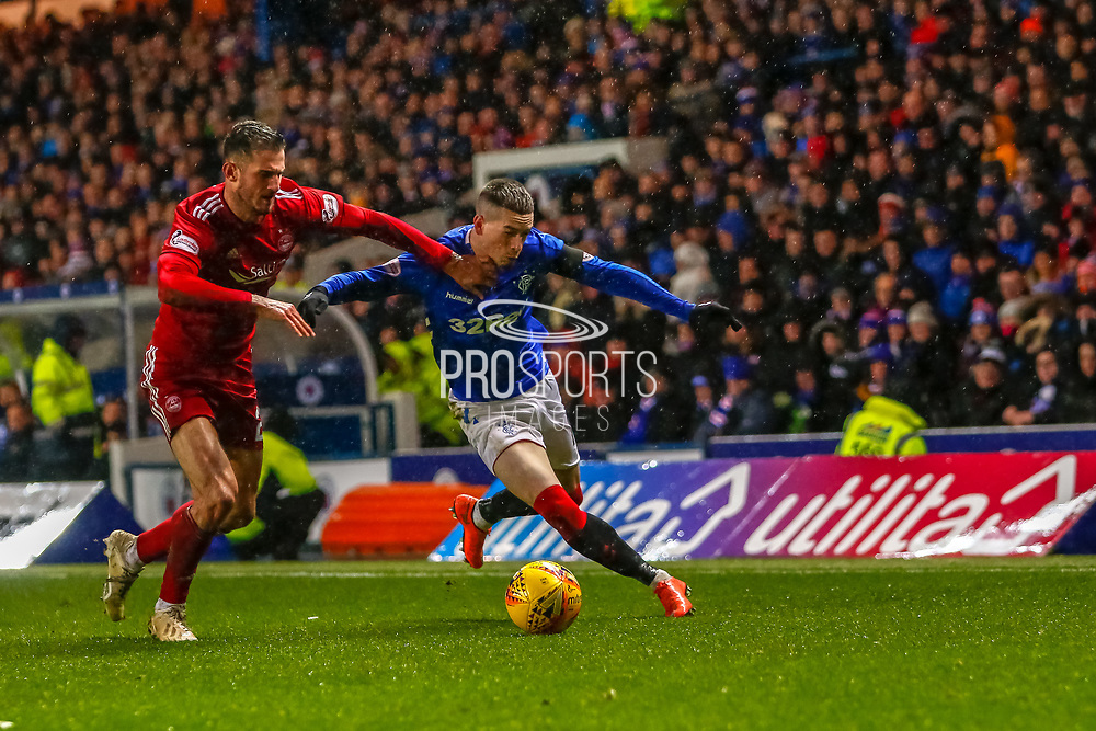 Ryan Kent beats Dominic Ball of Aberdeen FC during the William Hill Scottish Cup quarter final replay match between Rangers and Aberdeen at Ibrox, Glasgow, Scotland on 12 March 2019.