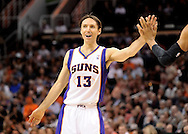 Mar. 14, 2012; Phoenix, AZ, USA; Phoenix Suns guard Steve Nash (13) is high fived while playing against the Utah Jazz during the first half at the US Airways Center. Mandatory Credit: Jennifer Stewart-US PRESSWIRE..