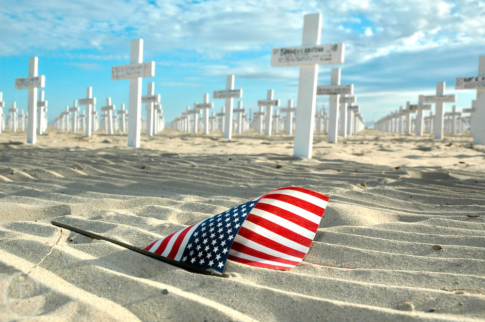 Fallen flag sits in the sand on the Santa Barbara Beach on February 26, 2006.