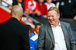Southampton manager Ronald Koeman jokes with Vitesse Arnhem manager Peter Bosz - Mandatory by-line: Jason Brown/JMP - Mobile 07966386802 - 31/07/2015 - SPORT - FOOTBALL - Southampton, St Mary's Stadium - Southampton v Vitesse Arnhem - Europa League
