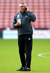 Derby County manager Nigel Pearson speaks on his mobile phone whilst holding a drink - Mandatory by-line: Matt McNulty/JMP - 27/07/2016 - FOOTBALL - Bramall Lane - Sheffield, England - Sheffield United v Derby County - Pre-season friendly