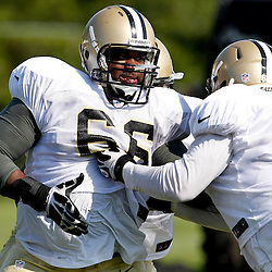 July 29, 2012; Metairie, LA, USA; New Orleans Saints guard Ben Grubbs (66) works against guard Eric Olsen (69) during a training camp practice at the team's practice facility. Mandatory Credit: Derick E. Hingle-US PRESSWIRE