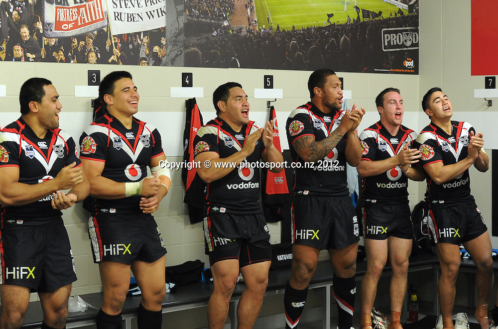 Warriors players sing the team song ain the dressing room after defeating the Broncos during the NRL Rugby League match, Vodafone Warriors v Brisbane Broncos at Mt Smart Stadium, Auckland, New Zealand on Saturday 5 May 2012. Photo: Andrew Cornaga/photosport.co.nz