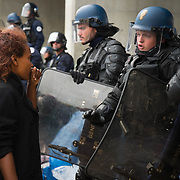 France , Calais, camp for refugees known as 'The Jungle'. September 21st 2015. French police oversee the removal of the tents and belongings in them, from under the flyover at the edge of the camp. A young Eritrean woman asks to retrieve her papers but her request falls on deaf ears.
