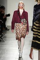 Alyona Subbotina walks the runway wearing Custo Barcelona Fall 2016 20th Anniversary Collection during New York Fashion Week on February 14, 2016