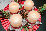 Celebrating Christmas with candles, pine cone and decorations