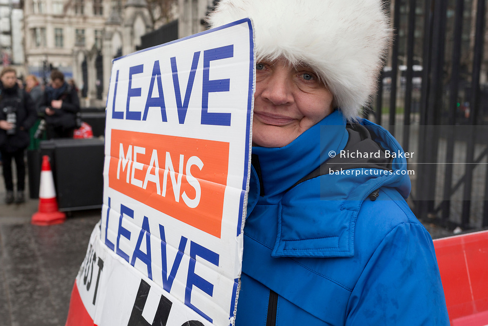 On the day that Prime Minister Theresa May meets with Labour leader Jeremy Corbyn in an attempt to break the Brexit deadlock in parliament, a pro-Leave protestor holds her placard outside the gates of Parliament in Westminster, on 3rd April 2019, in London, England.
