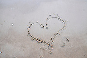 heart symbol etched in the sand at the beach