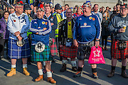 Ploice keep a low profile watch as Scots fans, in town for tonights international against England, join people of all backgrounds pay their respects - Silence in the Square oraganised by the British Legion in Trafalgar Square  - 11 November 2016, London.