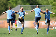 24 April 2008: (From left): Kacey White, Amy Rodriguez, Abby Wambach, and Lori Chalupny warm up. The United States Women's National Team held a training session on Field 3 at WakeMed Soccer Park in Cary, NC.