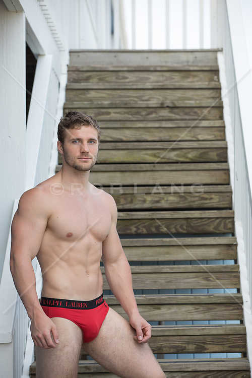hot man in briefs at a motel