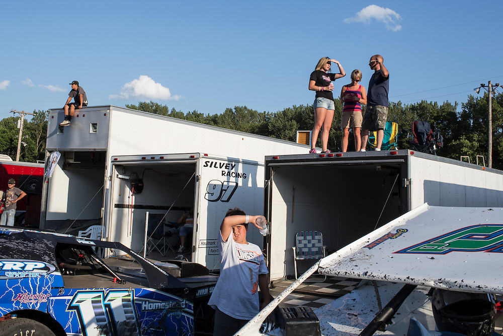 People gather to watch the races at the Hamilton County Speedway on Thursday, July 26, 2012 in Webster City, IA.